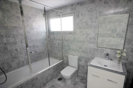Bathroom with marble and shower